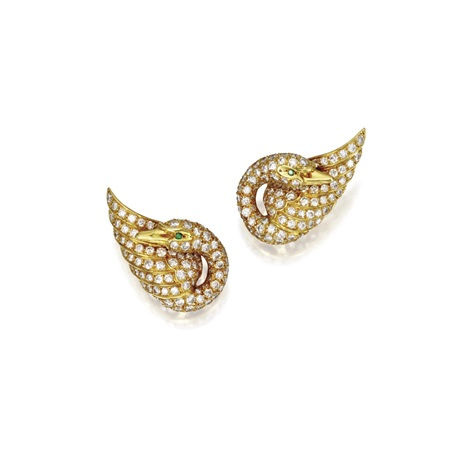 a pair of swan earclips by van cleef arpels