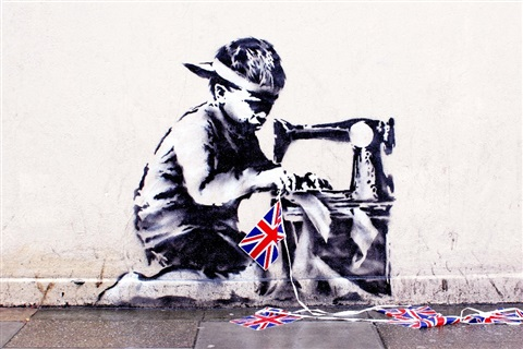 slave labor bunting boy london by banksy
