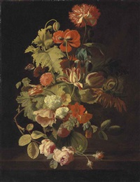 a carnation, iris, roses, tulips and other flowers in a glass vase on a stone ledge by simon pietersz verelst