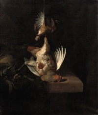 a partridge and other birds hanging above a draped stone ledge along with hunting paraphernalia and small birds by william gowe ferguson