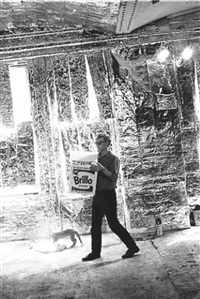 andy warhol carrying a brillo box by billy name