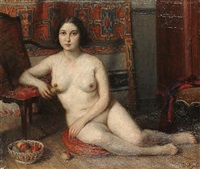 female nude seated on a cushion beside a bowl of fruit by charles-jean agard