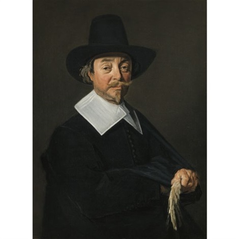 portrait of a man in black wearing a hat and holding a pair of gloves by frans hals the elder