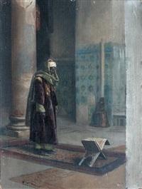 homme arabe debout devant un coran ouvert sur un portant by ludwig deutsch