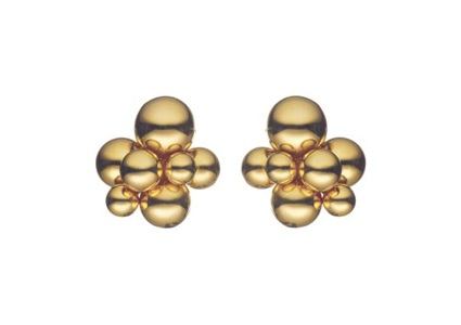a pair of gold earclips by marina b