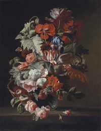 opium poppies, an iris, tulips, a sunflower, roses and other flowers in a glass vase on a ledge by simon pietersz verelst