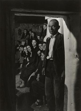wake-man in doorway (from spanish village series) by w. eugene smith