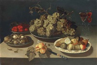 grapes, blackberries, raspberries, walnuts and hazelnuts on pewter platters, pears and other fruit on a porcelain platter, two façon-de-venise wine... by osias beert the elder