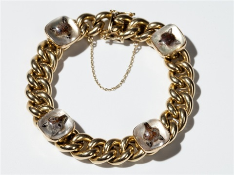 14 carat gold curb chain bracelet with fox head cabochons 1950