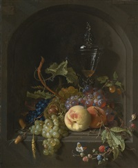 still life of grapes, peaches, blackberries, acorns, prickly fruit, an elaborate glass and various insects on a ledge in a niche by abraham mignon