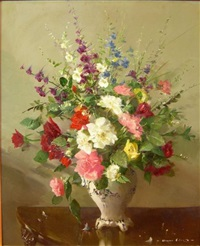 a still life of assorted flowers by vernon ward