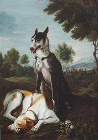 two dogs resting in an italianate mountainous landscape by jan fyt