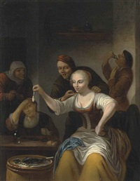 a barn interior with a woman seated holding up an opened clam and other figures gathered around the table and a barrel by gerrit lundens