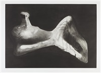 reclining figure in dark landscape by henry moore