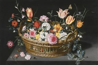 still life of flowers in a basket on a stone ledge by jan brueghel the younger