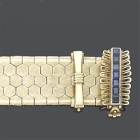 a gold and sapphire strap bracelet by sannit and stein