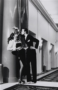 woman into man, lighting a cigarette, yves saint laurent pour vogue by helmut newton