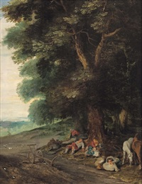 a wooded landscape with a peasant family resting under a tree by jan brueghel the younger