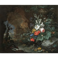 the interior of a grotto with a rock-pool, frogs, salamanders, a bird's nest and a large bouquet of flowers including poppies and lilies, a view of a landscape through the cave opening beyond by abraham mignon