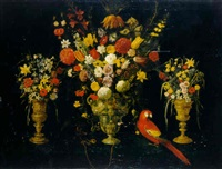 tulips, carnations, irises, daffodils, hyacinths and other flowers in three silver-gilt standing cups with parrot and squirrel by astolfo petrazzi