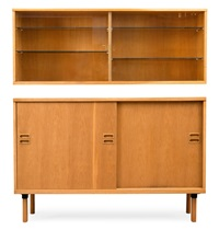 bureau with a sliding-door cabinet by maija heikinheimo
