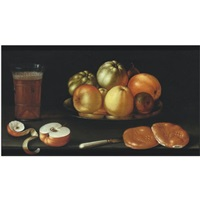 still life with apples and other fruit on a tazza, together with a glass of beer, a partly peeled apple, a knife and two bread rolls by cornelis jacobsz. delff