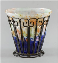 a wrought iron and cased glass bucket vase by daum and louis majorelle