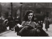 woman carrying a child in central park, n.y.c by diane arbus