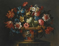 still life with flowers, including anemones, snowballs and yellow narcissi, in a wicker basket set upon a stone pedestal by juan de arellano