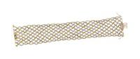 a gold bracelet by buccellati
