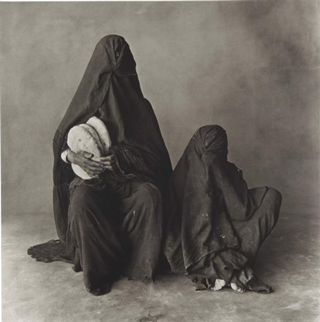 two women in black with bread, marocco by irving penn