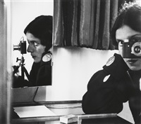 self-portrait in mirrors (self-portrait with leica) by ilse bing