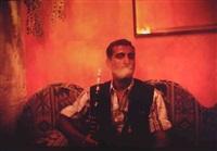 jabarlowe(?) smoking sheisha in café in paris by nan goldin
