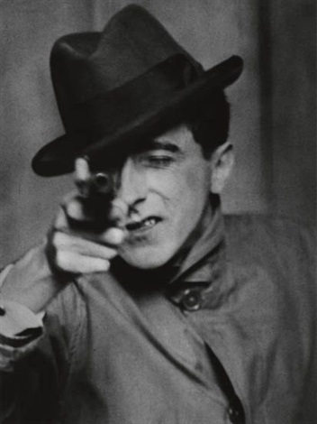 cocteau with gun paris by berenice abbott