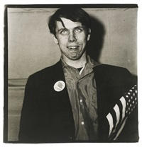 young boy with a button and flag in a pro-war parade, n. y. c.' (patriotic young man) by diane arbus