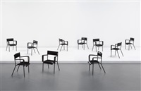 set of ten dining armchairs by jacques adnet