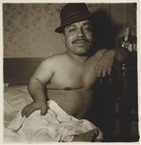 laura morales, a mexican dwarf in his hotel room, new york (from a box of ten photographs) by diane arbus