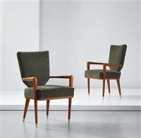 pair of 'bridge écusson' armchairs by jean royère