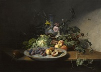a still life of fruit and vegetables with an imari dish, copper bowl and other porcelain by david emile joseph de noter