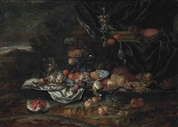 grapes, peaches and plums on a porcelain dish, with a roemer, a fish on a pewter charger and fruit in a tazza, with a partly-peeled lemon by jan pauwel gillemans the elder