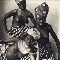 three dahomey girls, one reclining by irving penn