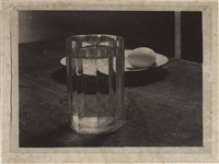 glass and egg on a plate by josef sudek