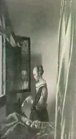 woman reading a letter by johannes van delft vermeer