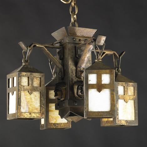 chandelier with monk heads by arts crafts