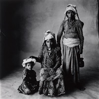 standing woman, sitting woman, and child (nepal) by irving penn