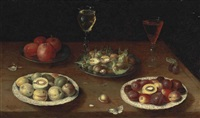 hazelnuts and walnuts, and apples on pewter platters, plums and nectarines on porcelain plates, with glasses of red and white wine, and a butterfly, on a wooden table by osias beert the elder