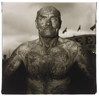 tattooed man at a carnival, md by diane arbus