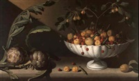 still life of fruit in a bowl with two artichokes by juan (fray) sanchez y cotan