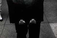 man with portfolio by roy decarava