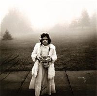 a flower girl at a wedding, conn by diane arbus